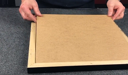Backing board into picture frame