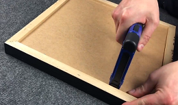 Sealing a picture frame with a point driver
